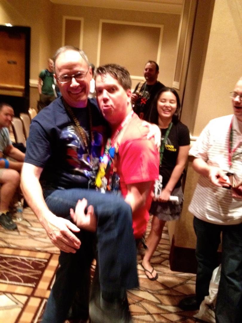 Jayson Street giving Awkward Hug to General Keith Alexander